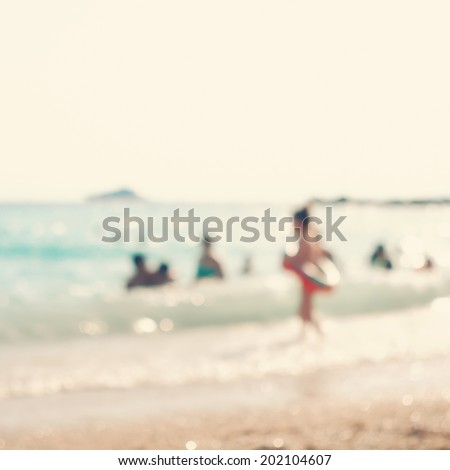 Blurred background.In the summer vacation.Silhouette of a girl running in the sea.Vintage style photo. - stock photo