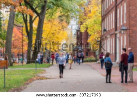 Blurred background of a university campus on a beautiful Fall day. - stock photo