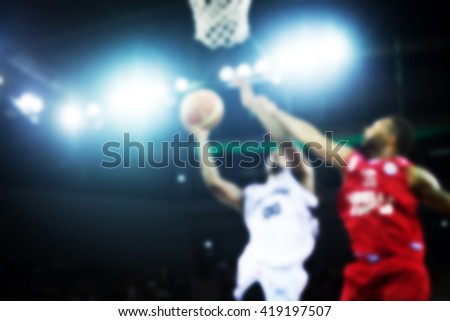 Blurred background of basketball players in court - stock photo