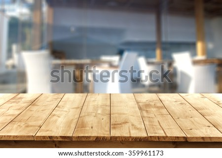 blurred background of beach bar at summer time with yellow wooden desk  - stock photo