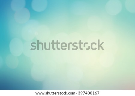 blurred background of blue gradient with bokeh and lens flare lights.blurred backdrop concept.pastel tone color.colorful elegant image:brightening sunshine day season:vintage tone filter effect - stock photo