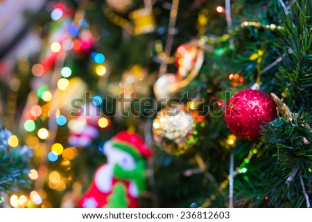 Blurred background of Christmas decorations, blinking led and pine tree. Vietnamese stores start selling xmas decorative products from late November every year on Hang Ma street, old quarter of Hanoi - stock photo