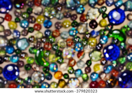 Blurred background of colorful glass marbles  - stock photo
