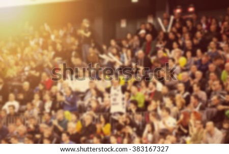 Blurred background of crowd of people at the stadium - stock photo
