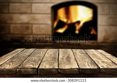 blurred background of fireplace and brown old table place  - stock photo