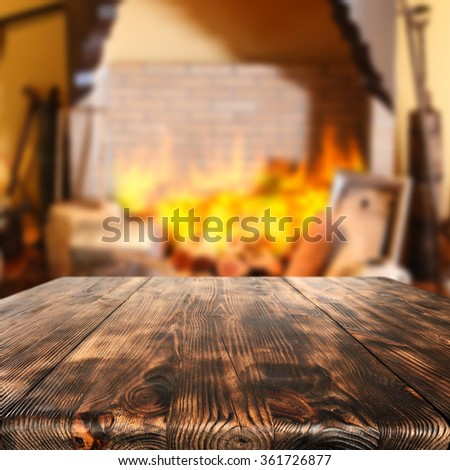 blurred background of fireplace and brown wooden desk and space for you  - stock photo
