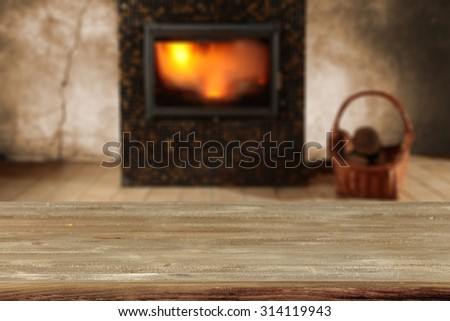 blurred background of fireplace and desk  - stock photo