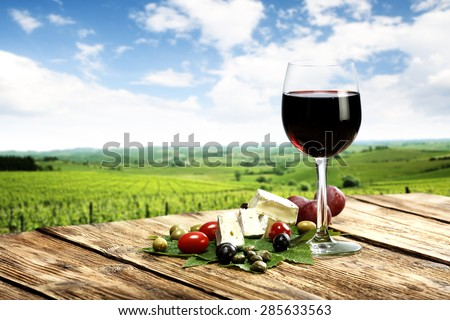 blurred background of Italy with glass of wine  - stock photo