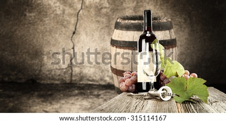 blurred background of old barrel and wine  - stock photo