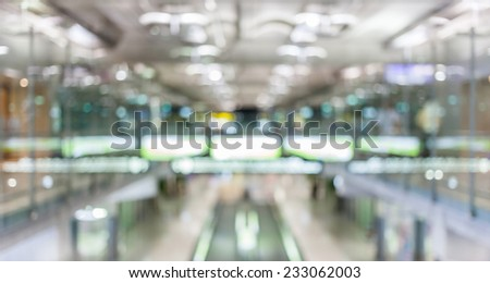 Blurred background of passenger hall and moving escalator in the Airport terminal. - stock photo