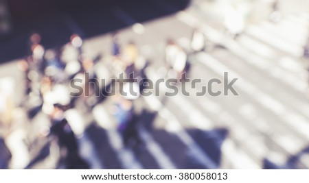 blurred background of people crossing street,top view. - stock photo