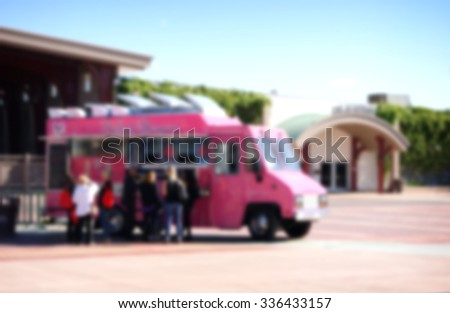 blurred background of people ordering at food truck - stock photo