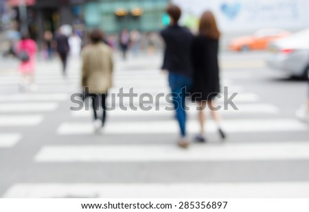 Blurred background of people walking on big city street,  zebra crossing abstract - stock photo
