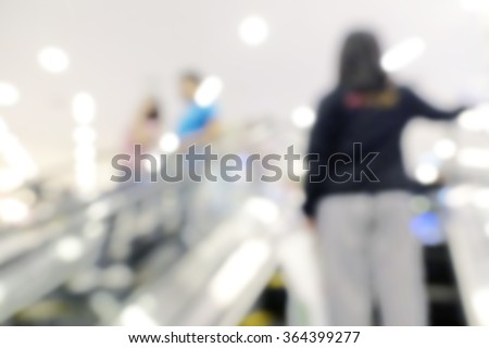 Blurred background of peoples on escalator motion blurred. shopping abstract. - stock photo