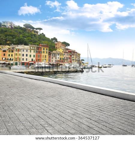 blurred background of Portofino port and old gray street  - stock photo