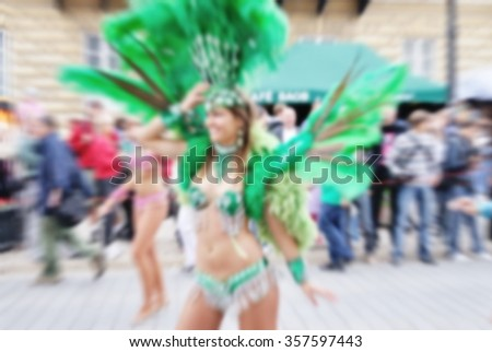Blurred background of Samba dancers during carnival - stock photo