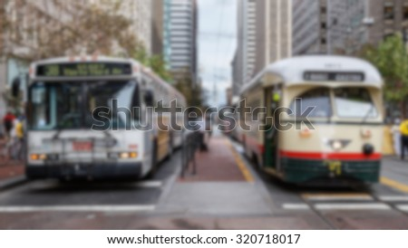 Blurred background of San Francisco public transportation vehicles. - stock photo