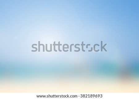 blurred background of sea with lens flare lights.abstract peaceful tranquil pacific ocean backdrop concept:summer sunny coastline color of day sky landscape.blur nature beach sea pastel texture - stock photo