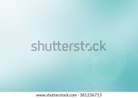 blurred background of sea with rays flare light.blur backdrop concept.pastel cool tone color.blurry colorful of blue gradient image:bright sunshine day on summer season:holiday vacation conception - stock photo