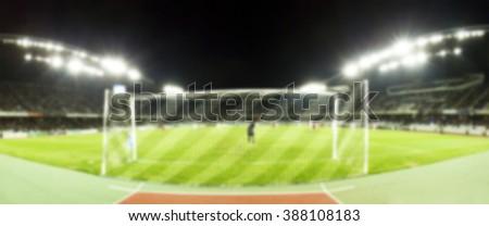 Blurred background of soccer stadium - stock photo