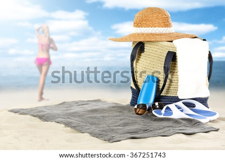 blurred background of summer coast and woman in pink bikini with sunny day on beach  - stock photo