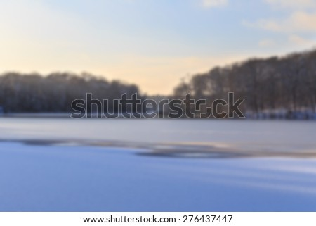 Blurred background of  view across partially frozen Lake Schlachtensee in Berlin, Germany in winter. - stock photo