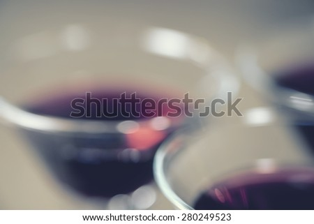 Blurred background of wine glass with warm tone. - stock photo