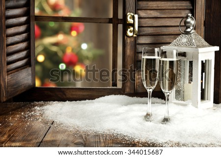 blurred background of xmas tree lights and window of glasses space and white snow and lamp and free place  - stock photo