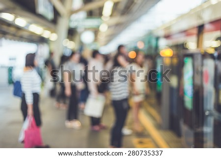 Blurred background : People stand at the sky train station, bangkok, Thailand - stock photo