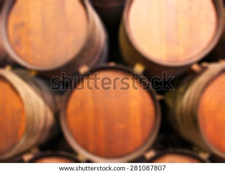 Blurred background : Row of wooden barrels of tawny portwine ( port wine ) in cellar, Porto, Portugal. vintage business and travel concept - stock photo