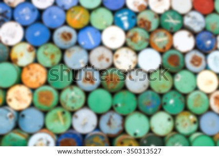 blurred background - stack of oil barrels - stock photo