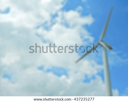 Blurred background Wind turbines to produce electricity against cloudy sky, Eco power. Wind turbines generating electricity.               - stock photo