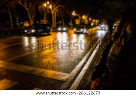Blurred background with some cars in motion. Nocturne city lights - stock photo