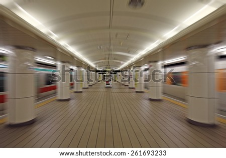 Blurred background: Zooming at velocity through an underground train station.  - stock photo