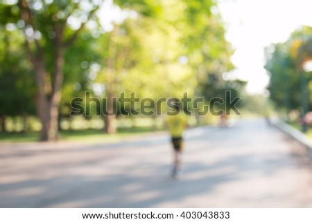 blurred backgrounds of people exercise at parks outdoor:blur of people running,walking,jogging at park:blur of nature park outdoor:blur and out of focus concept:blurred of sport and activity concept. - stock photo