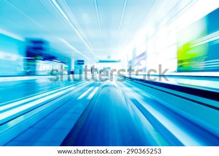 Blurred backround of moving futuristic escalator - stock photo