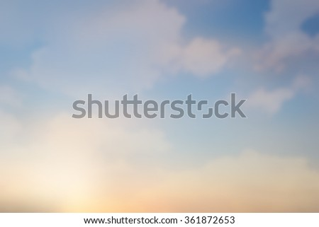 blurred beautiful natural sky clouds landscape background with lights.blurry sunshine wallpaper concept.backdrop pastel warm tone.idyllic shores sundown hour.abstract dream magic coastline dramatic - stock photo