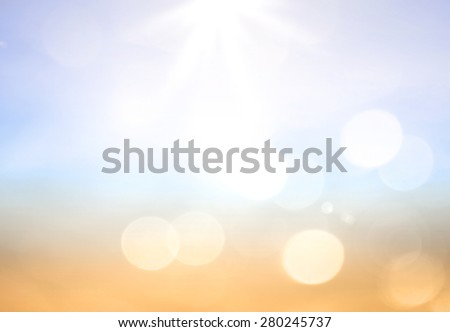 Blurred beautiful nature background. Sandy beach backdrop with turquoise water and bright sun light. Summer holidays concept. World ocean day concept. - stock photo