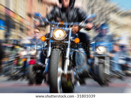 blurred bike riders rushing at city street - stock photo
