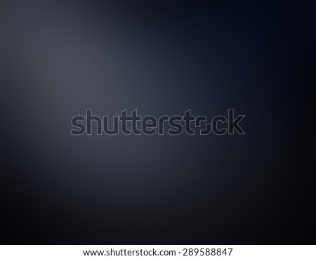 blurred black background with corner spotlight - stock photo