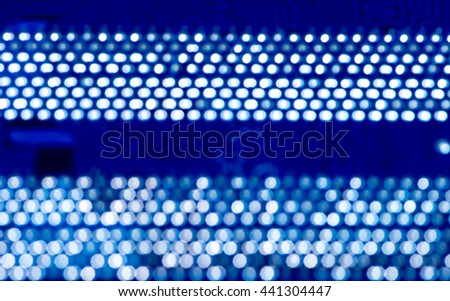 blurred blue pcb motherboard integrated circuit board pattern background with out of focus circles - stock photo