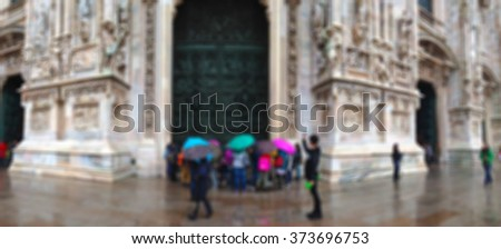 blurred blurry soft unfocused street city architecture cityscape view old vintage Duomo cathedral church gothic with group of people, in Milano, Italy. background wallpaper - stock photo