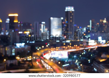 Blurred bokeh highway intersection with city lights background - stock photo