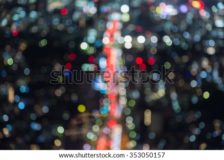 Blurred bokeh light city road top view at night - stock photo