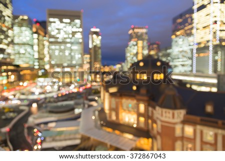 Blurred bokeh light night view Marunouchi business district and Tokyo Station - stock photo