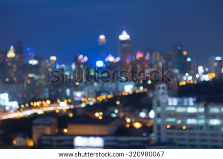 Blurred bokeh multiple lights of city at night - stock photo