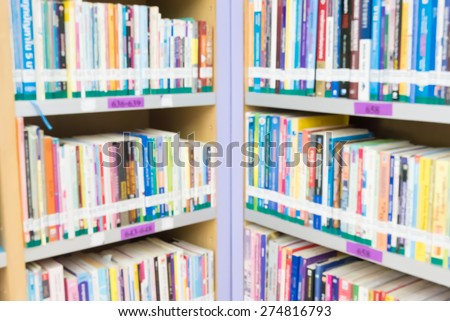 Blurred books in public library. Blurred effect. Background for you pictures - stock photo