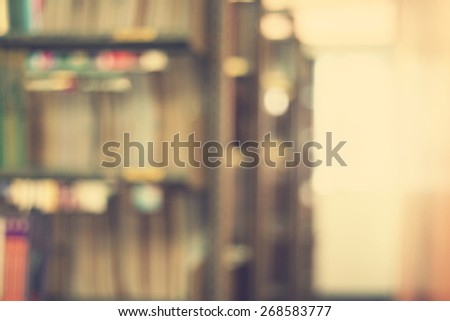 Blurred books on shelf in public library. Blurred effect. Background for you pictures - stock photo