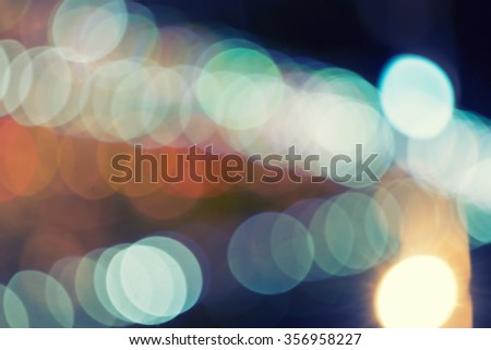 Blurred building and bridge with lights - stock photo