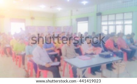 Blurred Business man making a presentation at office. Business executive delivering a presentation to his colleagues during meeting business training, explaining business plans to his employees. - stock photo